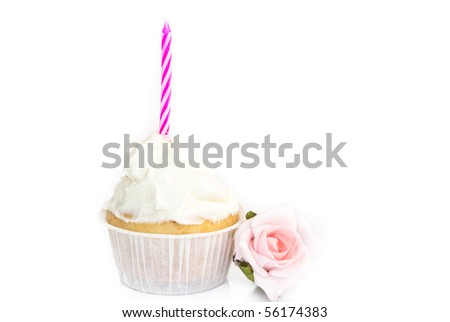 A pink birthday cupcake isolated on white background
