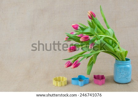 a pink, blue and yellow Spring and Easter arrangement - stock photo