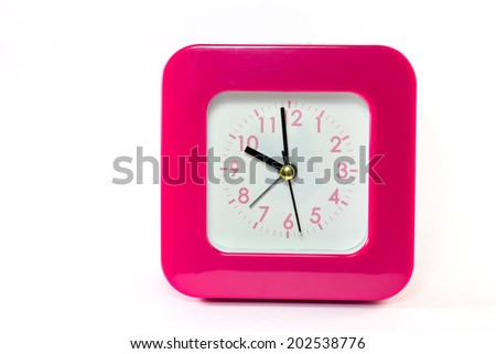 a pink clock isolated on white - stock photo