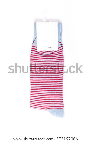 A pink cotton socks with empty(blank) label, stripes on the bottom isolated white.  - stock photo
