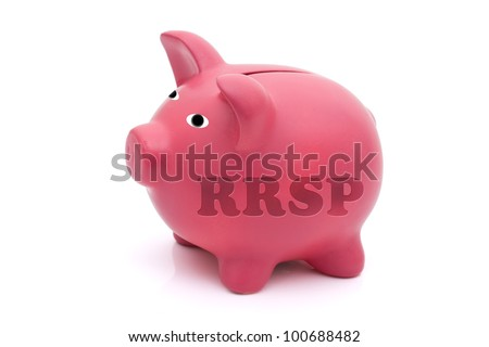 A pink piggy bank with rrsp on it isolated on white, Saving for your retirement - stock photo