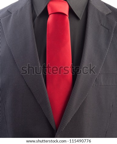 A pinstriped men's business suit with a red tie and black shirt. - stock photo