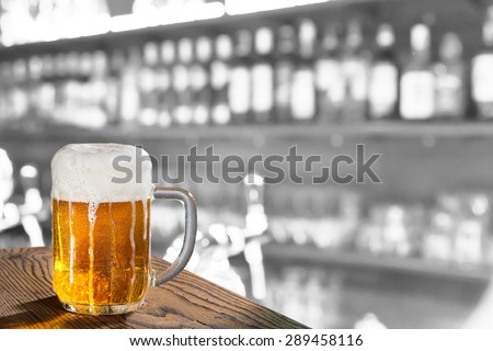 a pint in the pub, composite image - stock photo
