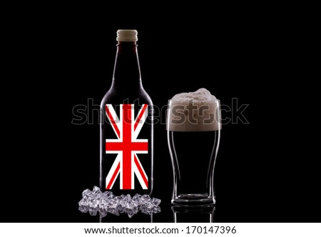 A Pint of Dark Beer and a Beer Bottle on a Black Background. British Beer Concept - stock photo