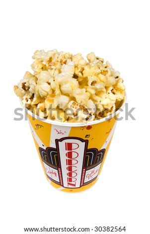A piping hot container of movie popcorn shot with emphasis on the popcorn.  Isolated on white for the designer's convenience. - stock photo