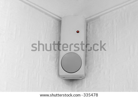 A PIR (passive infra red) movement sensor, part of a burglar alarm system - stock photo