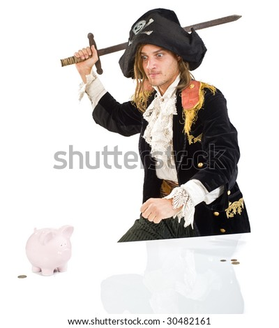a pirate aiming a sward at  a piggy bank isolated on white - stock photo
