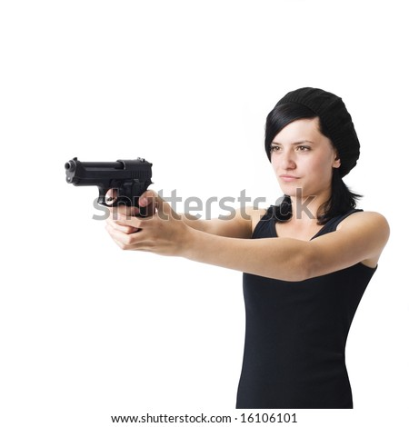 A pissed teenage girl aims a handgun in anger - stock photo