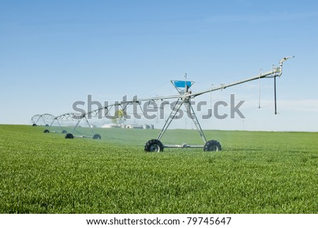 A pivot irrigation system. - stock photo