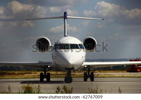 A Plane at the airport - stock photo