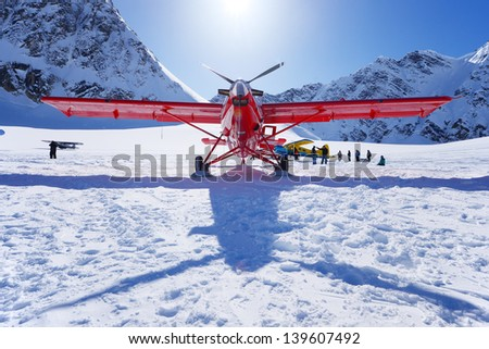 a plane landing on glacier in alaska