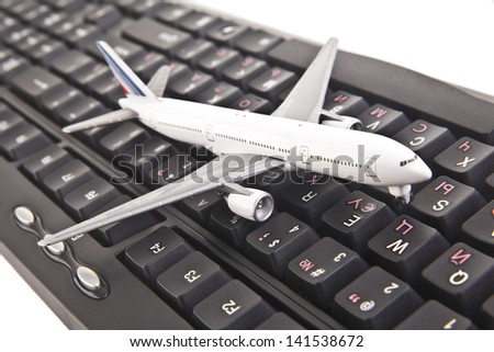 a plane layout on keyboard, to illustrate online booking or purchase of plane ticket or business travel concepts. - stock photo