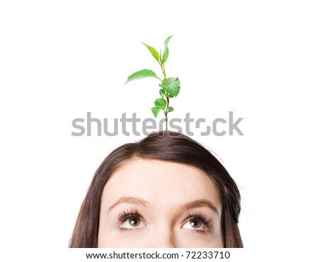 A plant growing out of my head a young woman. - stock photo