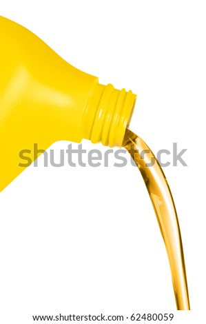 A plastic container of engine oil pouring in front of a white background.  For use as a design element or automobile maintenance inference. - stock photo