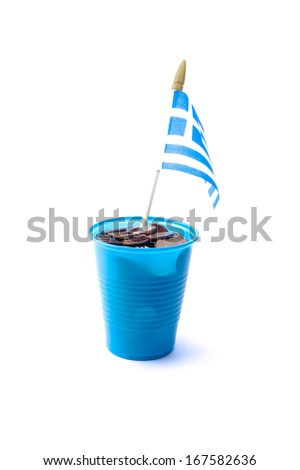 a plastic container with coins and the Greek flag - stock photo