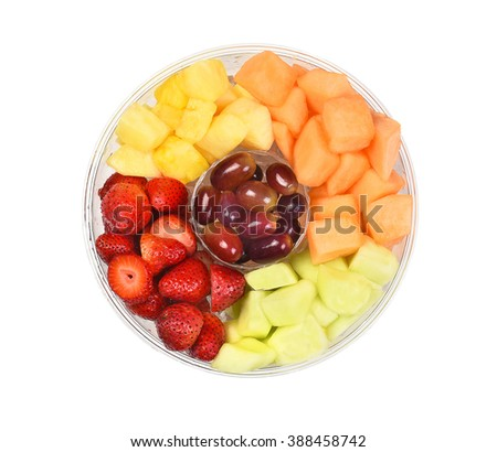 A plastic tub of fresh cut fruit. Isolated on white fruits include, Strawberry, Pineapple, Apple, Cantaloupe, Honeydew Melon and Grapes.