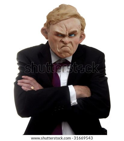A  plasticine (modeling clay) model of a cross or grumpy man with arms crossed wearing a suit (isolated).