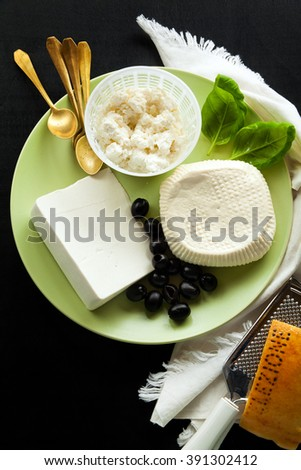 a plate of Cheese as a Snack or a healthy Appetizer cheese. Presentation of cheese products - stock photo
