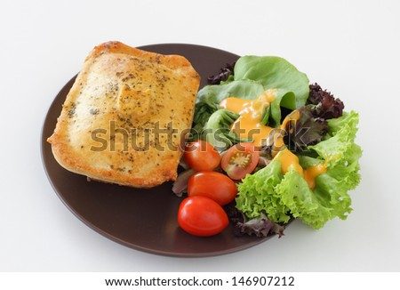 A plate of chicken pie with salad - stock photo