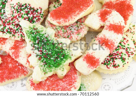 A plate of decorated Christmas sugar cookies - stock photo