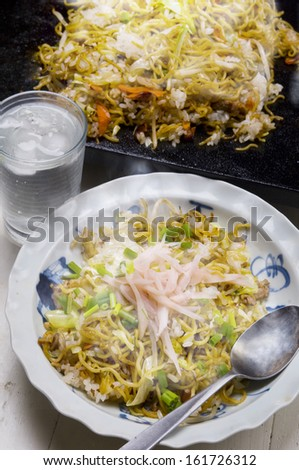 A plate of food and a glass of water. - stock photo