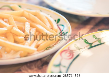 A plate of french fries with catchup - Vintage picture style, Shallow DOF - stock photo
