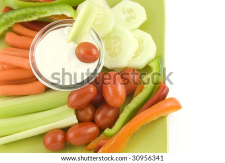 A plate of fresh cut vegetables and ranch dip,  on white background with copy space - stock photo