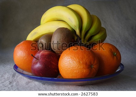 A plate of fresh fruit - stock photo
