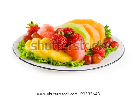 A plate of fruit on white