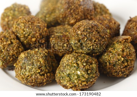 A plate of homemade falafal Egyptian-style chickpea, parsley and coriander spicy balls on a plate after being fried.