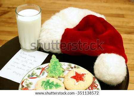 A plate of homemade sugar-cookies for Santa on Christmas Eve. - stock photo