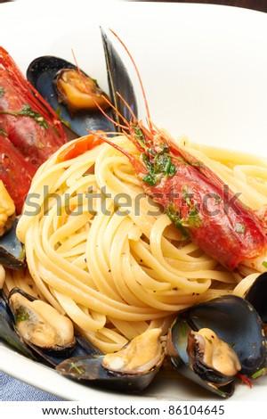 a plate of italian spaghetti with fresh seafood - stock photo