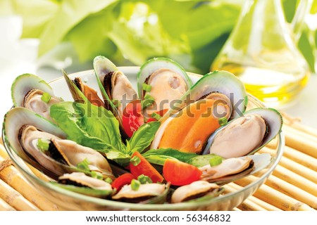 A plate of New Zealand mussels and olive oil - stock photo