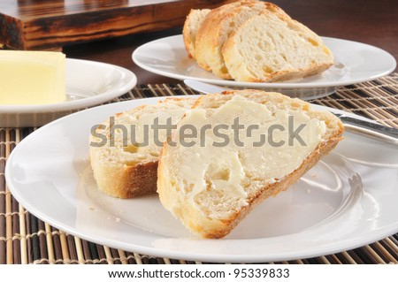 A plate of sliced buttered French or Italian bread