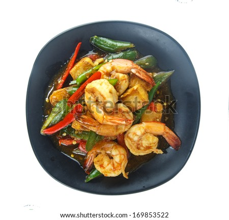 A plate of stir-fried shrimp with chilli on white background.