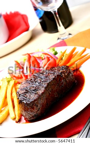 a plate of tender and juicy beef steak - stock photo