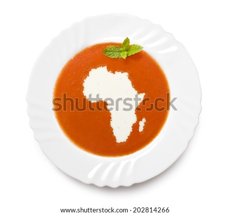 A plate tomato soup with cream in the shape of Africa.(series) - stock photo