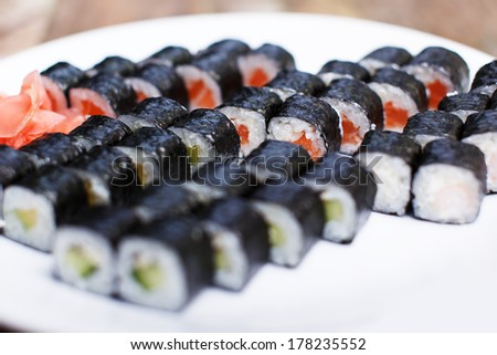 A plate with five sushi sets and ginger - stock photo