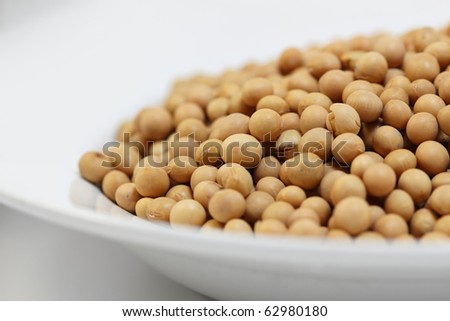 A plate with soy beans. Selective focus. - stock photo