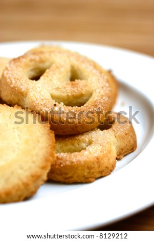 A plateful of delicious warm butter cookies with sprinkling of sugar