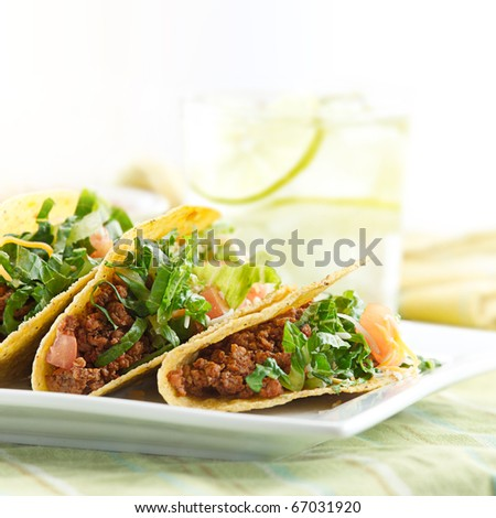 a platter of three beef tacos - stock photo