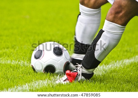 A Player is Shooting a Football in a Game - stock photo