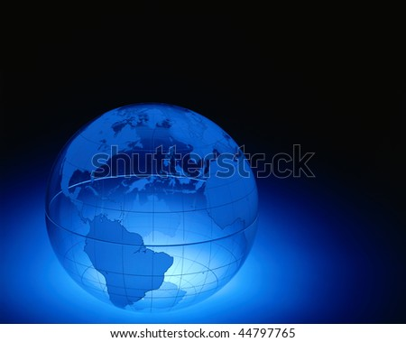 A plexiglas globe showing North and South America , Europe and Africa with space for copy