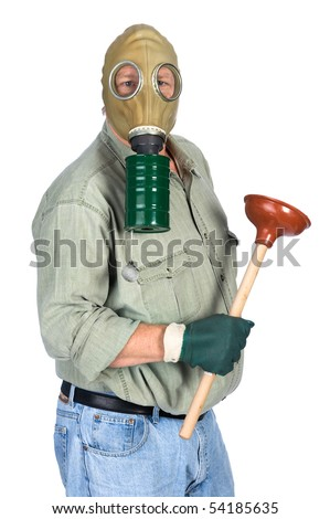 A plumber wears his gas mask as he prepares to unplug a toilet. - stock photo