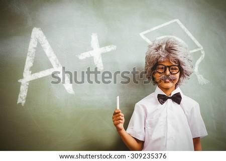 A plus grade against boy dressed as senior teacher in front of blackboard - stock photo