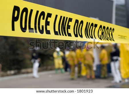 A police line in front of a HazMat decontamination shower. - stock photo