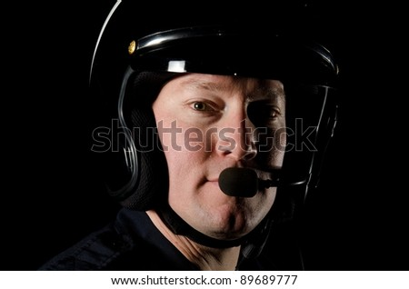 a police motorcycle officer during his night shift. - stock photo