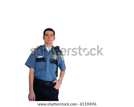A police officer standing in his uniform - stock photo