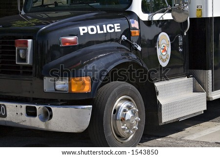 A police paddy wagon parked outside the police station - stock photo