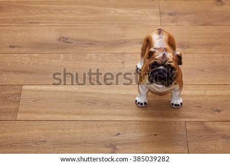 A porcelain statuette of dog on the wood textured floor